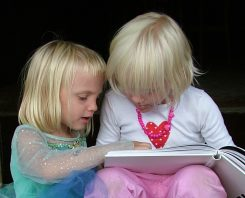 Young girls reading a book